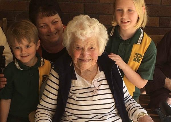 Elderly woman with children